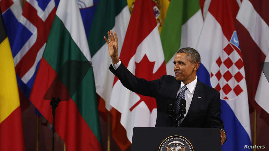 U.S. President Barack Obama waves after his speech at the Bozar concert hall in Brussels March 26, 2014