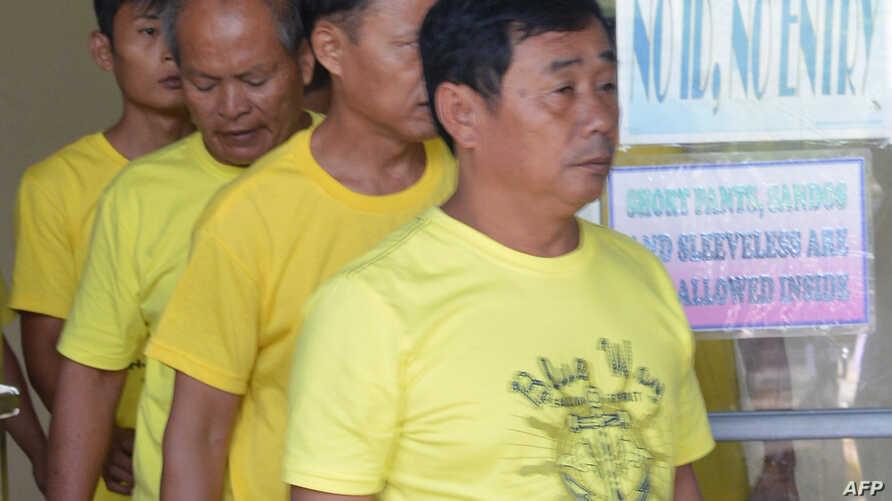 A group of Chinese fishermen leave a court in Puerto Princesa, Palawan island, Nov. 24, 2014, after they were found guilty of poaching.