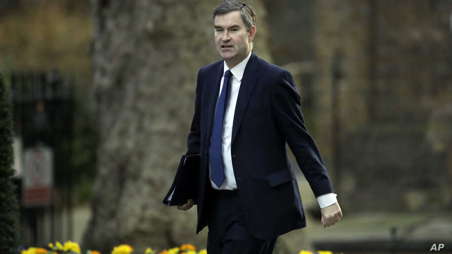 Britain's Lord Chancellor and Secretary of State for Justice David Gauke arrives for a cabinet meeting at 10 Downing Street in London, Feb. 26, 2019.