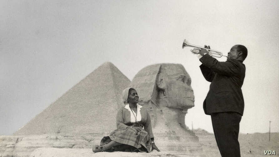 Louis Armstrong and his wife Lucille pose in front of the Sphinx near Cairo, Egypt in 1961. Credit: Courtesy of the Louis Armstrong House Museum