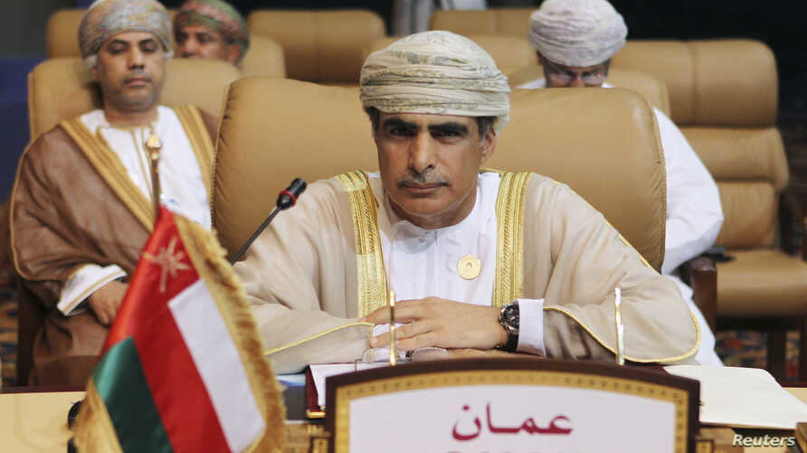 FILE - Oman's Oil Minister Mohammad bin Hamad bin Saif al-Rumhi attends during the opening session of the first Gas Exporting Countries Forum (GECF) summit in Doha, Nov. 15, 2011.