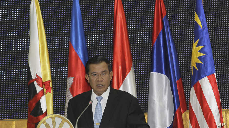 Cambodian Prime Minister Hun Sen speaks at the opening of the 45th Association of Southeast Asian Nations Foreign Ministers' Meeting in Phnom Penh, Cambodia, July 9, 2012.