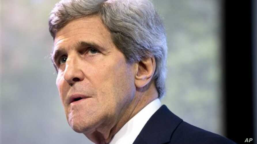 """Secretary of State John Kerry pauses as he delivers a speech on climate change on Sunday, Feb. 16, 2014, in Jakarta, Indonesia. Climate change may be the world's """"most fearsome"""" weapon of mass destruction and urgent global action is needed to combat"""