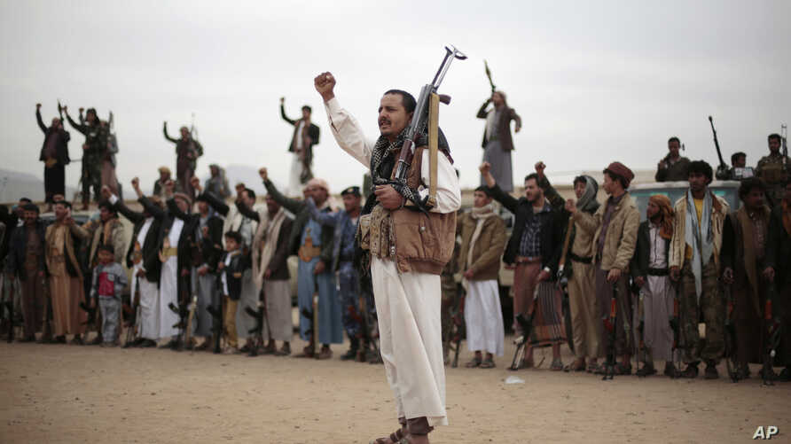 Tribesmen loyal to Houthi rebels hold their weapons as they chant slogans during a gathering aimed at mobilizing more fighters into battlefronts in several Yemeni cities, in Sanaa, Yemen, Thursday, Nov. 10, 2016.