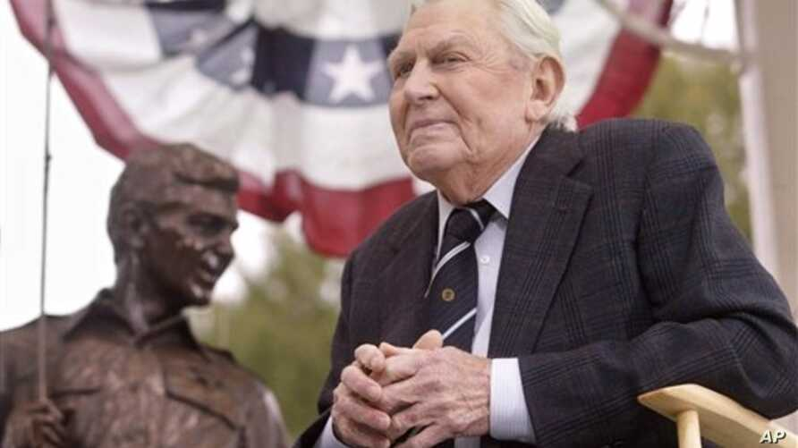 """Griffith near bronze statue of Andy and Opie from """"The Andy Griffith Show,"""" Raleigh, N.C., Oct. 28, 2003."""