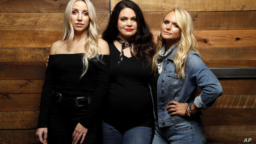 """Ashley Monroe, from left, Angaleena Presley and Miranda Lambert of the Pistol Annies pose for a photo at Sony Nashville in Nashville, Tenn., to promote their newest album, """"Interstate Gospel,"""" Oct. 1, 2018."""