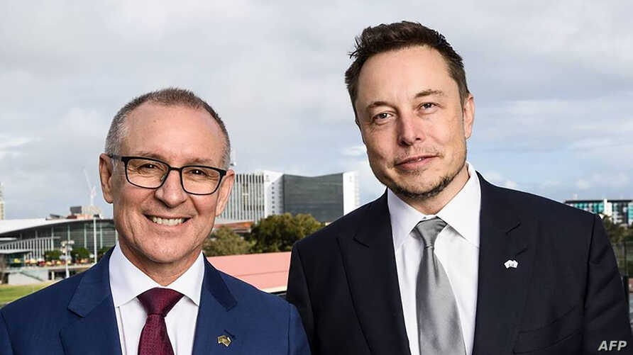 A handout photo taken and received on July 7, 2017, shows South Australia's Premier Jay Weatherill (L) and Tesla Motors CEO Elon Musk (R) at an announcement in Adelaide. AFP photo /South Australia Department of Premier and Cabinet.