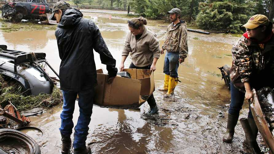 Local residents help salvage and clean property in an area inundated after days of flooding in Hygeine, Colorado, Sept. 16, 2013.