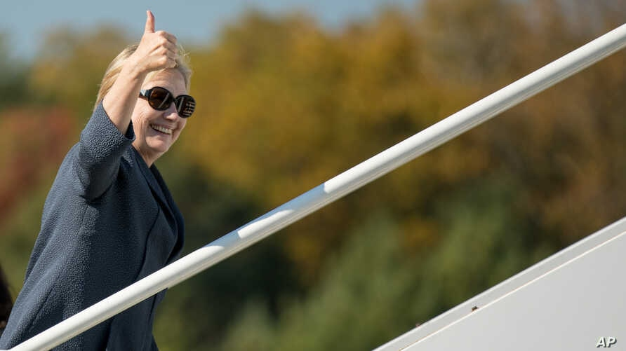 Democratic presidential candidate Hillary Clinton boards her campaign plane at Westchester County Airport in White Plains, N.Y., Oct. 18, 2016, to travel to Las Vegas for the third presidential debate.