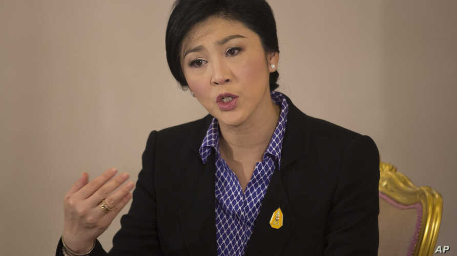 Thai Prime Minister Yingluck Shinawatra speaks during an interview with foreign media at Government House in Bangkok, Dec. 7, 2013.