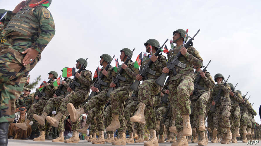 Afghan National Army soldiers march during a ceremony in a military base in the Guzara district of Herat province on Feb. 28, 2019.