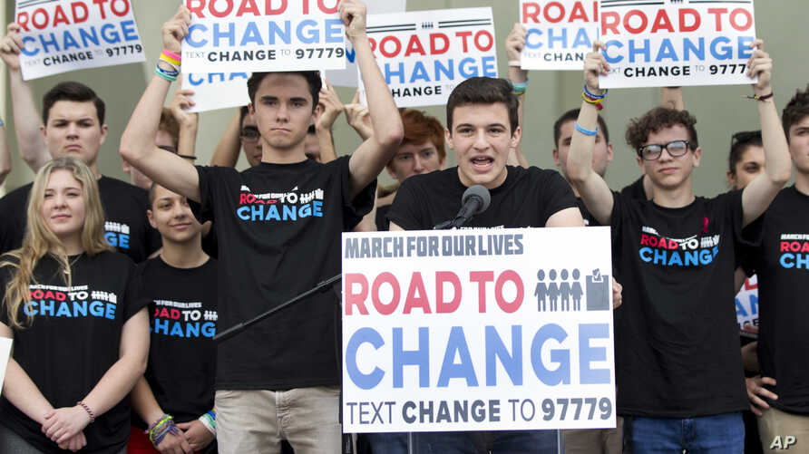 """Cameron Kasky, center, speaks during a news conference, June 4, 2018, in Parkland, Fla. A day after graduating from high school, a group of Florida school shooting survivors has announced a multistate bus tour to """"get young people educated, registere"""