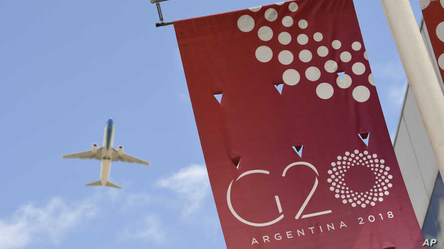 A jet liner flies over the G20 summit venue at the Costa Salguero Center in Buenos Aires, Argentina, Nov. 28, 2018.
