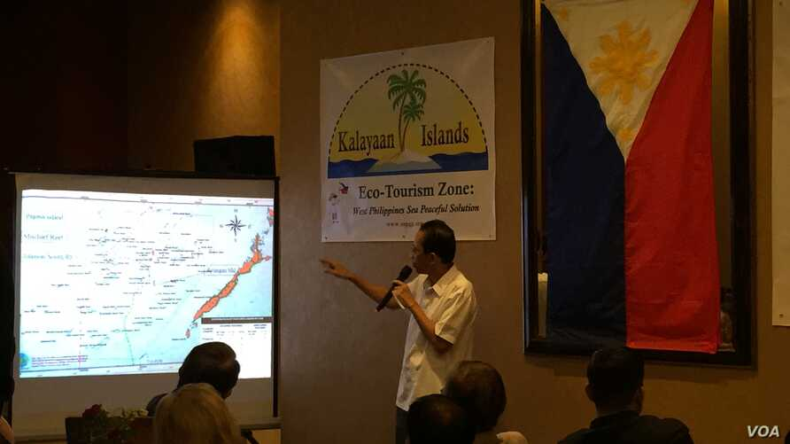 "Mayor Eugenio Bito-onon of the Kalayaan Group of Islands, the Philippines-controlled outcroppings in the Spratly Islands, points out the Philippines' claims in the Spratlys during a fundraising dinner to gain support for a proposed ""ecotourism zone"""