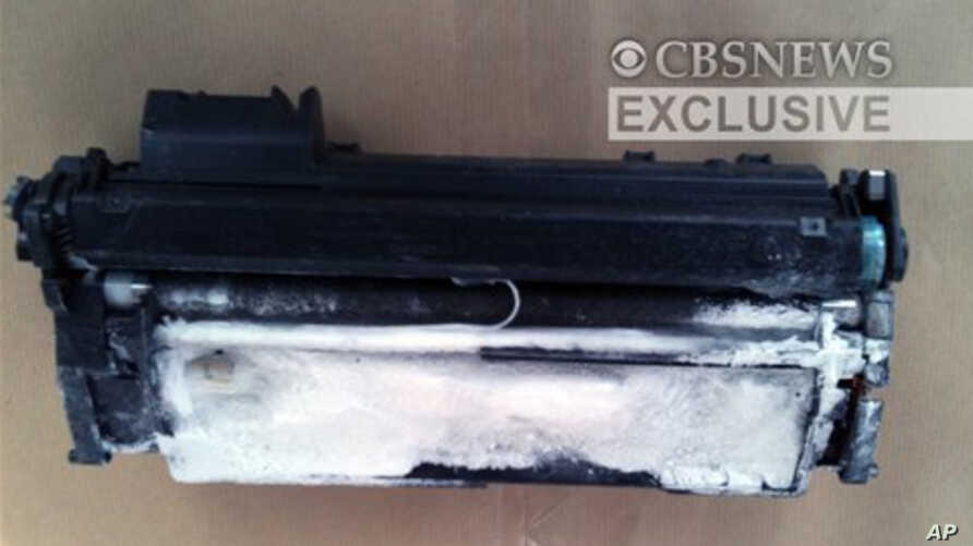This image provided by CBS News shows a printer toner cartridge with wires and powder found in a package aboard a plane searched in East Midlands, north of London, 29 Oct 2010
