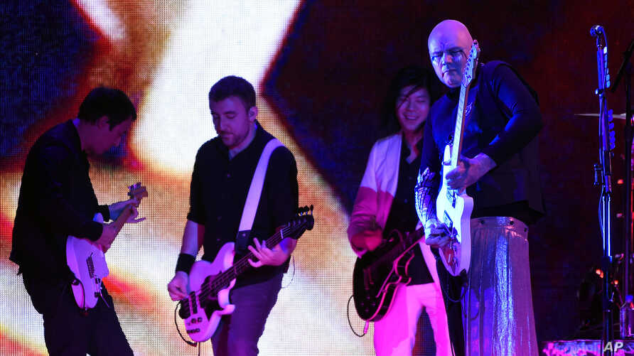 Jeff Schroeder, from left, Jack Bates, James Iha and Billy Corgan of Smashing Pumpkins perform at The Forum, Aug. 30, 2018, in Inglewood, California