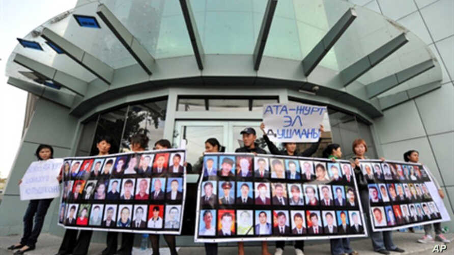 People hold posters with pictures of their killed relatives during a rally near the office of former Kyrgyz president Kurmanbek Bakiyev's Ata-Zhurt party in Bishkek on 6, Oct. 2010.  Parliamentary elections are set for Sunday, the tenth.