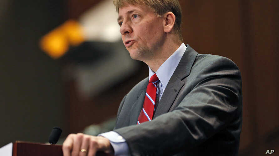 FILE - In this March 26, 2015, file photo, Consumer Financial Protection Bureau Director Richard Cordray speaks during a panel discussion in Richmond, Va. The Consumer Financial Protection Bureau has proposed a massive overhaul of the multibillion do