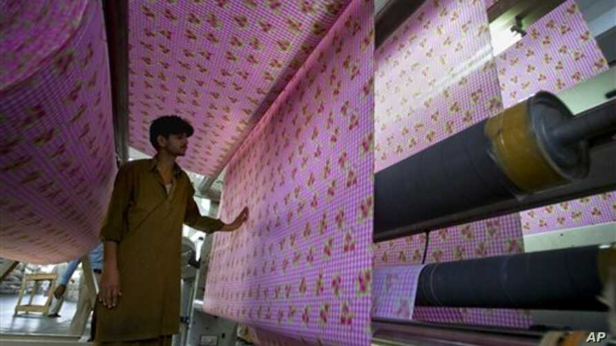 Pakistani worker at a textile factory in Faisalabad, Pakistan.