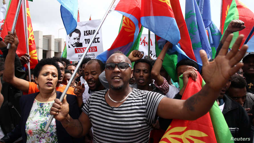 Eritrean refugees participate in a demonstration in support of a U.N. human rights report accusing Eritrean leaders of crimes against humanity in front of the Africa Union headquarters in Ethiopia's capital, Addis Ababa, June 23, 2016.
