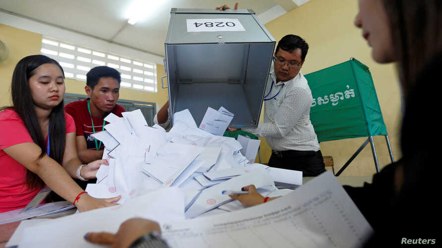 Officials begin the process of counting ballots after polls have closed in Cambodia's general election, at a polling station in Phnom Penh, Cambodia July 29, 2018.