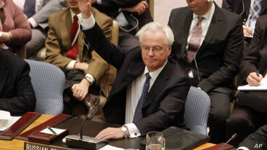 Russian representative Vitaly Churkin vetoes a draft resolution backing an Arab League call for Syrian President Bashar Assad to step down during a meeting of the United Nations Security Council at United Nations headquarters on Saturday, Feb. 4, 201