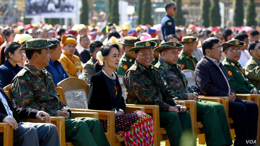 Aung San Suu Kyi sits amid military representatives at the 70th anniversary of the Panglong Agreement, Feb. 12, 2017. (Facebook/ Myanmar State Counsellor)