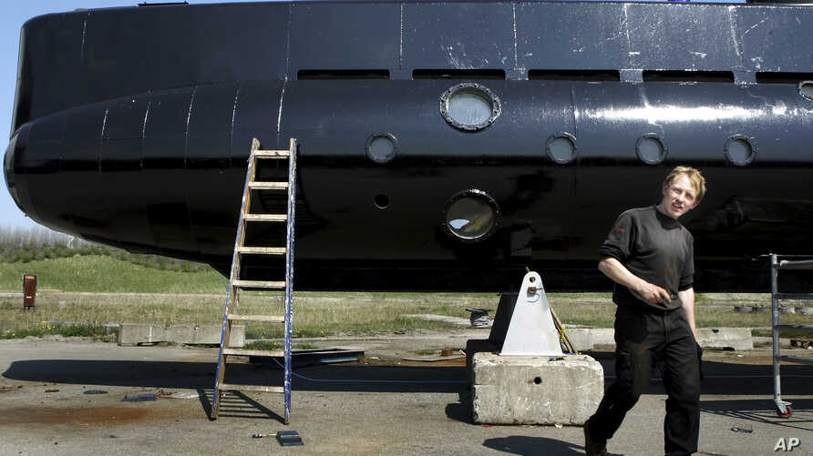 FILE - Submarine owner-builder Peter Madsen is seen with his craft in a April 30, 2008, photo.