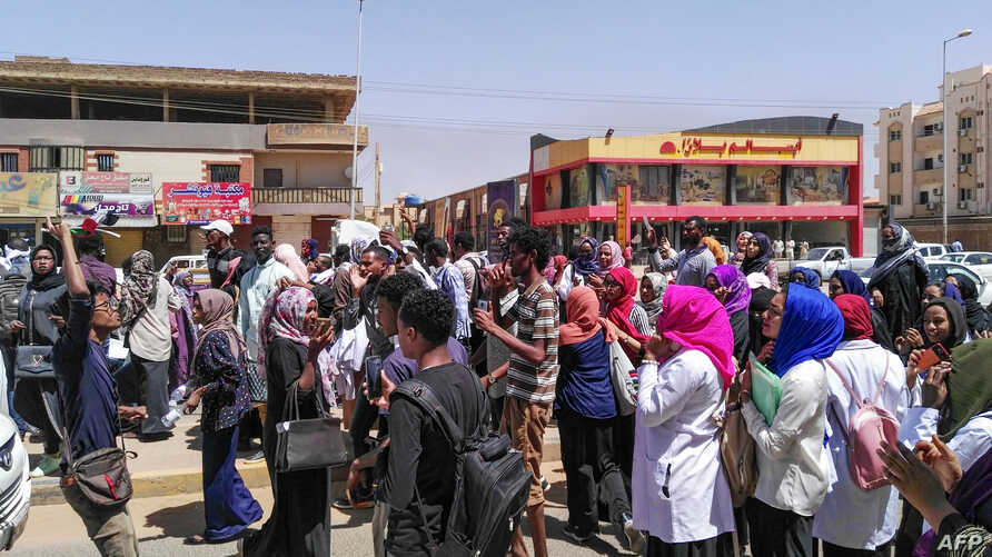"""Protesters shout """"freedom, peace, justice""""  during an anti-government demonstration in Khartoum, Sudan, March 18, 2019."""