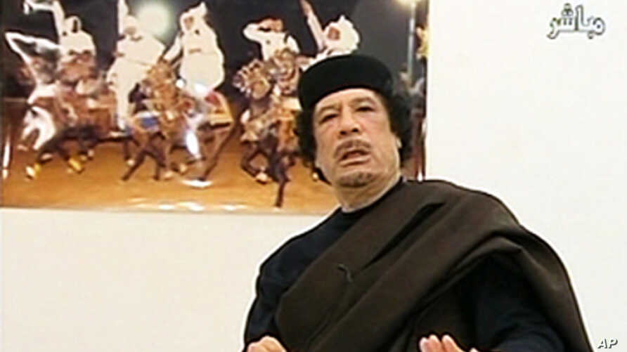 Libyan leader Moammar Gadhafi speaks during a live speech in this still image taken from video April 30, 2011