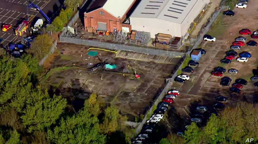 In this image made from video provided by Sky News, the site of a helicopter crash is seen near a carpark by the King Power stadium in Leicester, England, Oct. 28, 2018.