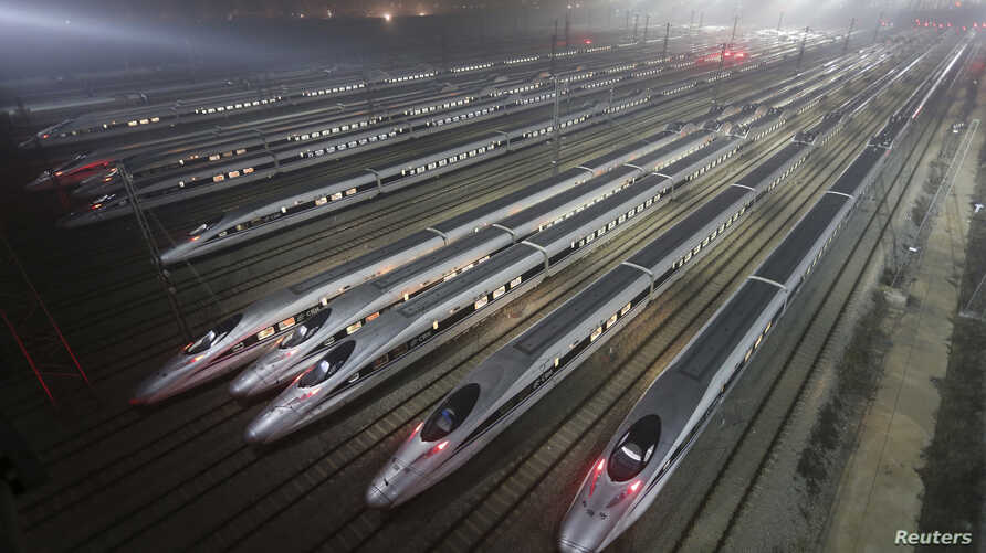CRH380 (China Railway High-speed) Harmony bullet trains are seen at a high-speed train maintenance base in Wuhan, Hubei province, early December 25, 2012.