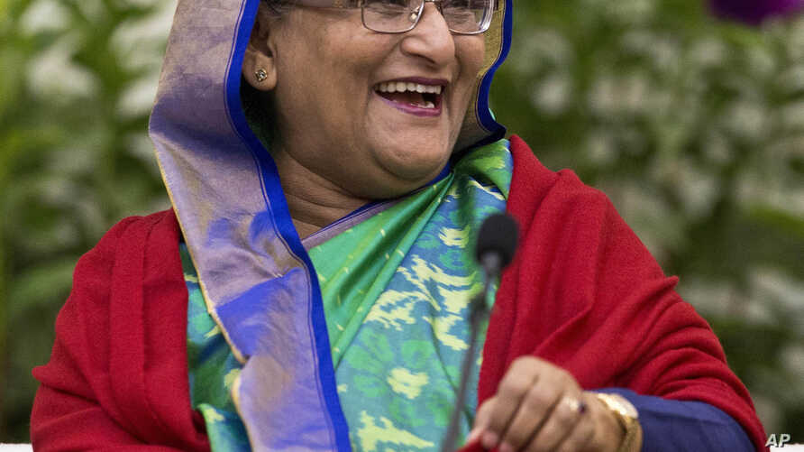 Bangladeshi Prime Minister Sheikh Hasina interacts with journalists in Dhaka, Bangladesh, Dec. 31, 2018.