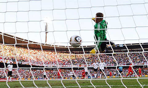 Germany's goalkeeper Manuel Neuer eyes the ball shot by England player Frank Lampard before the goal was disallowed during the 2010 World Cup round of 16 soccer match, 27 Jun 2010