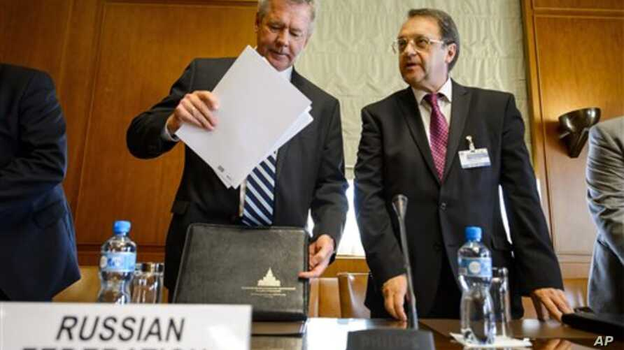 Russian Deputy Foreign Minister Gennady Gatilov (L) and Russian Deputy Foreign Minister Mikhail Bogdanov arrive at the United Nations office in a bid to organize the conference on Syria,  in Geneva, June 2013.