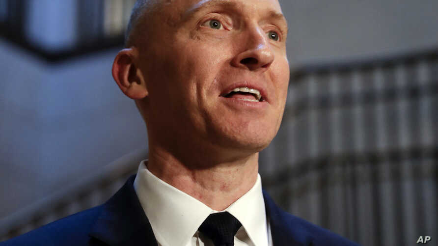 Carter Page, a foreign policy adviser to Donald Trump's 2016 presidential campaign, speaks with reporters following a day of questions from the House Intelligence Committee, on Capitol Hill in Washington, Nov. 2, 2017.