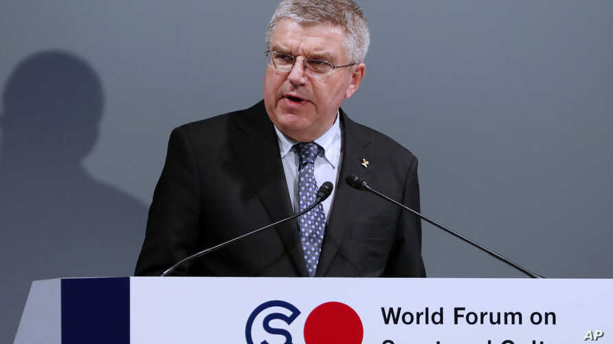 FILE - In this Oct. 20, 2016, photo, International Olympic Committee President Thomas Bach delivers a speech at World Forum on Sports and Culture in Tokyo.