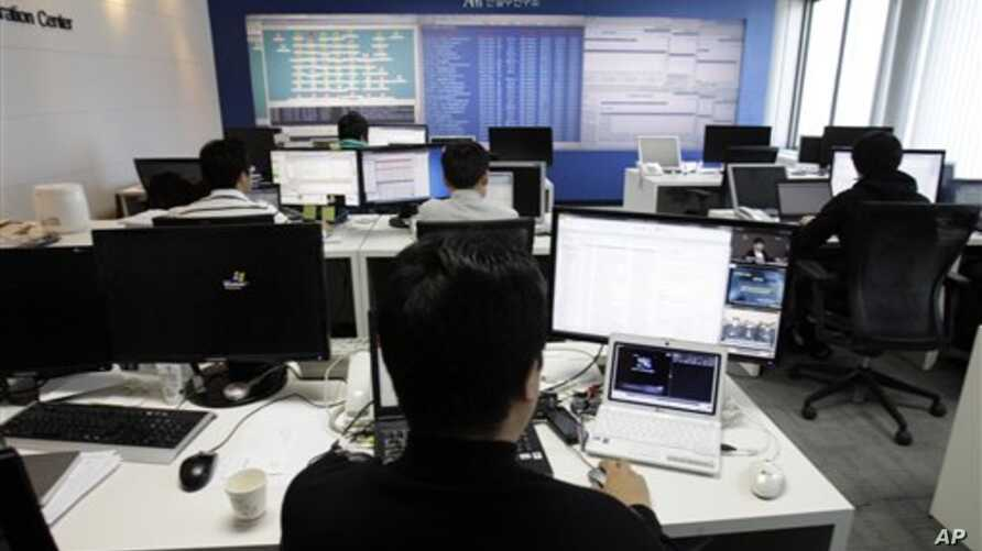 Technicians of AhnLab Inc. work against online attacks at the company's Security Operation Center in Seoul, South Korea, March 4, 2011