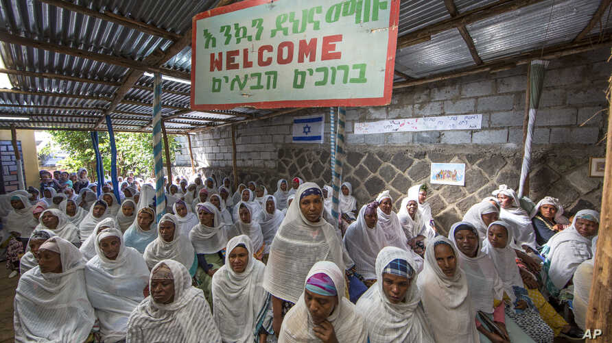 """Members of Ethiopia's Jewish community gather below a banner reading """"Welcome"""" in Amharic, English and Hebrew, to protest the Israeli decision not to allow all of them to emigrate to Israel, leaving their families divided between the two countries, i"""