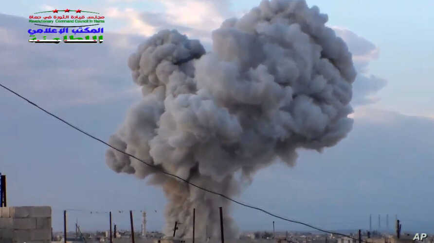 An image by Syrian activists purports to show smoke rising after a Russian airstrike hit buildings in the town of Latamna, near Hama in eastern Syria, Oct. 7, 2015.