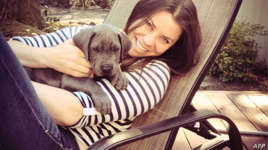 FILE - Brittany Maynard, shown with her Great Dane puppy, Charlie, took a lethal dose of medication prescribed by a doctor in Oregon on Saturday. Maynard was battling brain cancer.