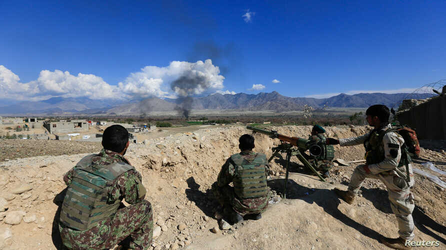 Afghan security forces take position during a gun battle between Taliban and Afghan security forces in Laghman province, Afghanistan March 1, 2017.