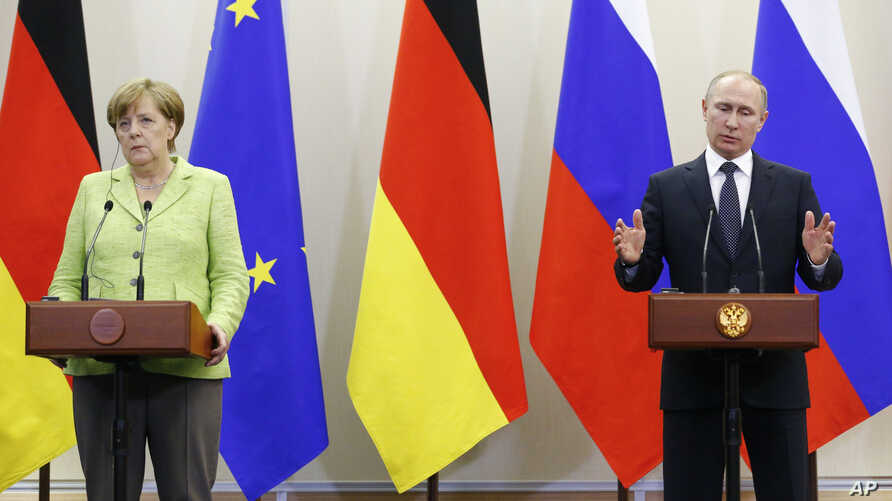 Russian President Vladimir Putin, right, gestures as he and German Chancellor Angela Merkel speak to the media after their talks at Putin's residence in the Russian Black Sea resort of Sochi, Russia, Tuesday, May 2, 2017.