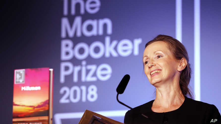 Writer Anna Burns smiles after she was presented with the Man Booker Prize for Fiction 2018 by Britain's Camilla, the Duchess of Cornwall, during the prize's 50th year at the Guildhall in London, Oct. 16, 2018.