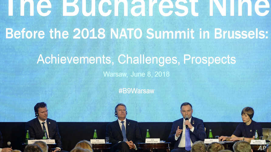 From left, speaker of the Chamber of Deputies of the Czech Republic Radek Vondracek, Romania's President Klaus Iohannis, Poland's President Andrzej Duda, and Estonia's President Kersti Kaljulaid attend a discussion on NATO, in Warsaw, Poland, June 8,