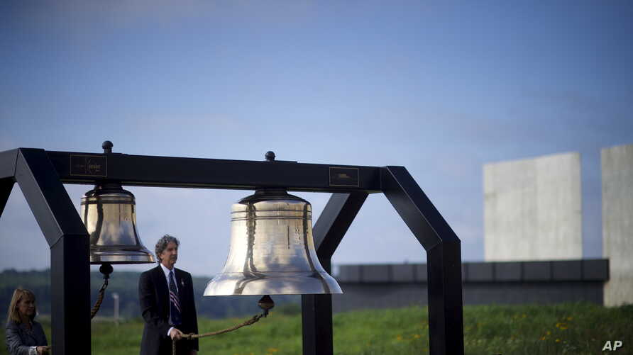 FILE - Bells are tolled for each of the 40 passengers that perished on Flight 93 during a memorial service at the Flight 93 National Memorial, which officially opened yesterday in Shanksville, Pennsylvanian Sept. 11, 2015.