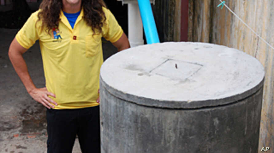 Cordell Jacks, who heads IDE Cambodia's water and sanitation program, stands next to one of the award-winning EZ Latrines that the charity hopes will help improve sanitation in rural Cambodia