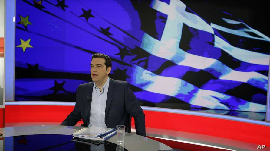 Greece's Prime Minister Alexis Tsipras prepares for a TV interview at the State Television (ERT) in Athens, June 29, 2015.