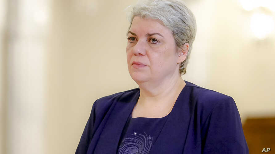 FILE - Sevil Shhaideh, 52, stands at the Romanian presidency before being sworn in as regional development minister in Bucharest, Romania.