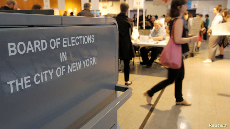 People vote in the New York primary elections at a polling station in the Brooklyn borough of New York City,April 19, 2016.